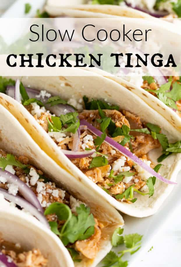 Chicken Tinga makes the most delicious shredded chicken tacos! Flavorful, tender, juicy and smoky! Cooking them is a breeze in your slow cooker. Also works perfectly for Enchiladas, Burritos, Tostadas, Nachos, and all your favorite Mexican Inspired dishes! #chickentinga #slowcooker #crockpot via @artfrommytable