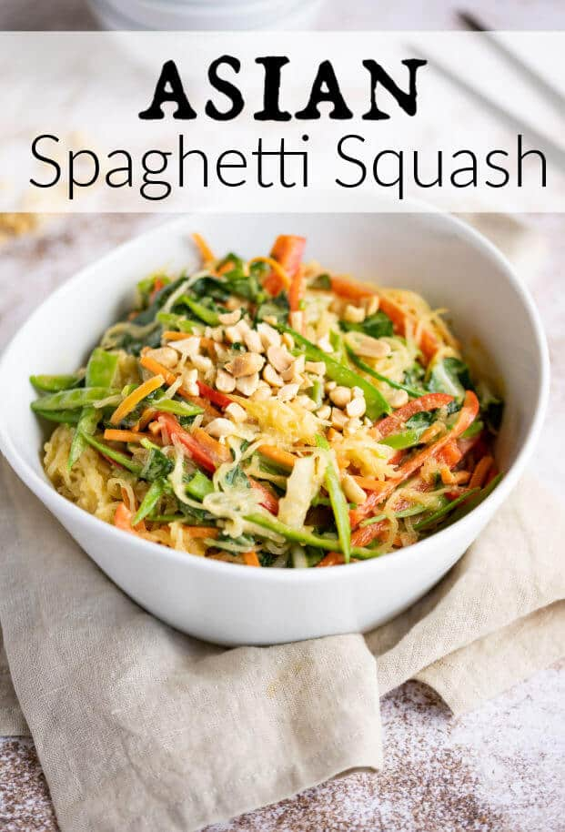 asian style spaghetti squash and vegetables mixed together in a white bowl topped with peanuts via @artfrommytable