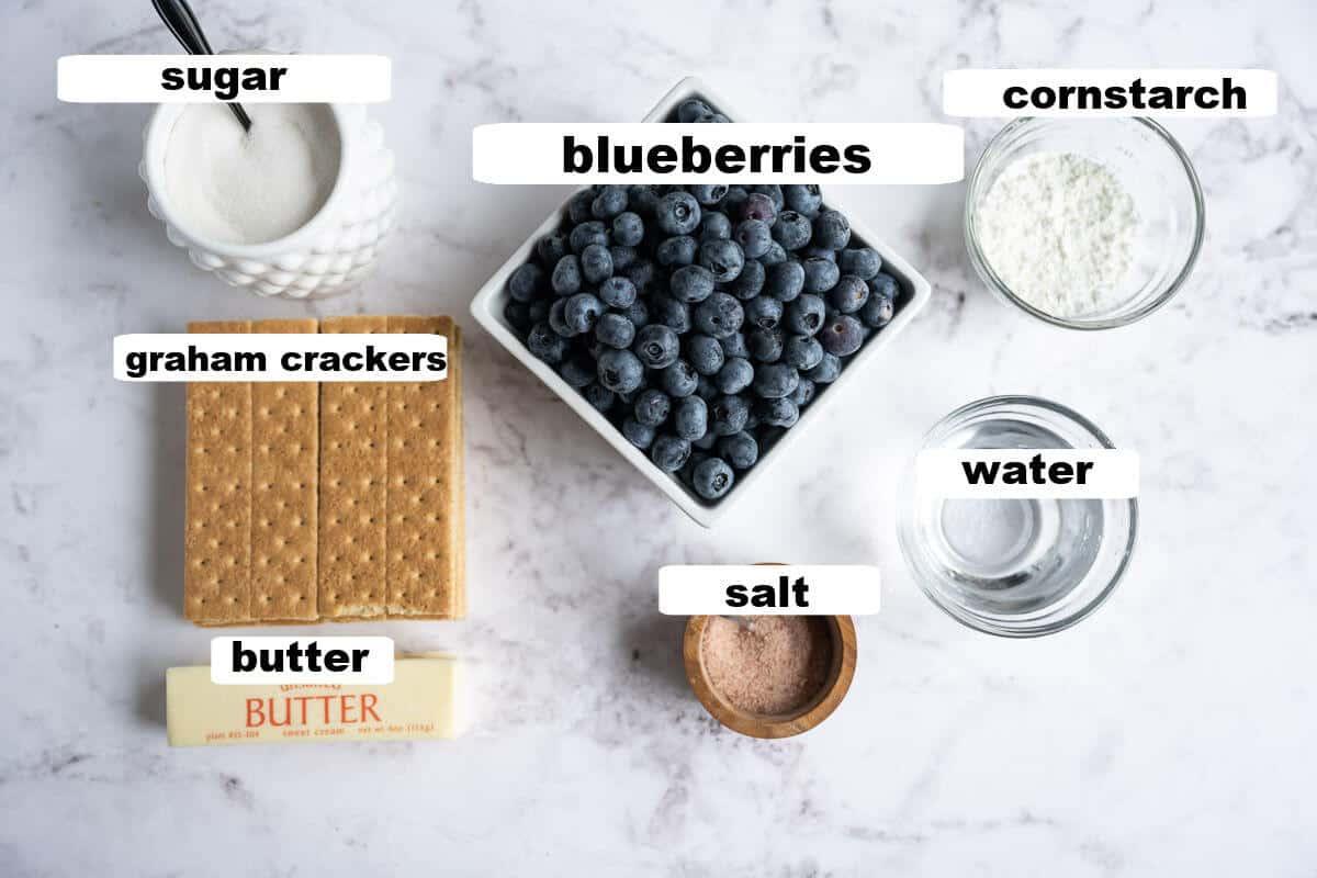 ingredients for blueberry pie: blueberries, sugar, cornstarch, water, salt, butter, graham crackers
